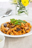 Fusilli with mushroom in tomato sauce Stock Images