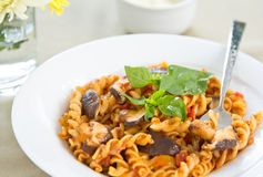 Fusilli with mushroom in tomato sauce Stock Photo