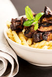 Fusilli with mushrooms Stock Photos