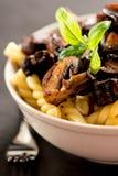 Fusilli with mushrooms. Italian cuisine Royalty Free Stock Images