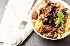Fusilli with mushrooms Royalty Free Stock Image