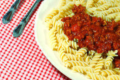 Fusilli noodles with meat sauce on a plate Royalty Free Stock Photos