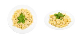 Fusilli Pasta Al Dente with Parmigiano Reggiano Cheese Isolated. Fusilli Spirale Pasta Al Dente with Parmigiano Reggiano Cheese, Spices and Basil in Restaurant stock images