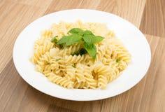 Fusilli Pasta Al Dente with Parmigiano Reggiano Cheese. Fusilli Spirale Pasta Al Dente with Parmigiano Reggiano Cheese, Spices and Basil in Restaurant Plate stock images