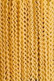 Fusilli pasta as background for Italian cuisine. Full frame close-up from above view of raw fusilli bucati lunghi pasta as background for traditional Italian stock photography