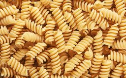 Fusilli pasta background. Close up of dry fusilli pasta background royalty free stock photos