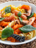 Fusilli pasta with baked salmon Stock Image