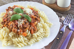 Fusilli pasta with bolognese sauce Royalty Free Stock Images