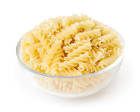 Fusilli pasta in bowl isolated on white background Stock Photo