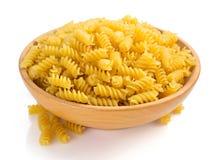 Fusilli pasta in bowl  on white Stock Photos