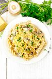 Fusilli with mushrooms on board top Stock Images