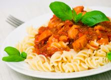Fusilli pasta with chicken breast in tomato sauce Royalty Free Stock Images