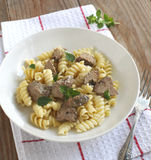 Fusilli pasta with chicken liver, oregano and parmesan cheese Royalty Free Stock Images