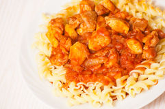 Fusilli pasta with chicken in tomato sauce Stock Photography