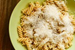 Fusilli Pasta. Close up of delicious home made fusilli pasta with parmesan cheese and olive oil decorated with fresh basil on black slate Cacio e Pepe royalty free stock image