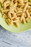 Fusilli Pasta. Close up of delicious home made fusilli pasta with parmesan cheese and olive oil on marble slate royalty free stock photo