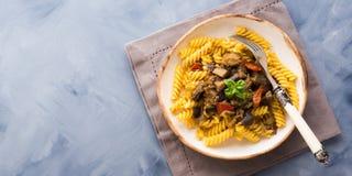 Fusilli pasta with eggplant sauce. Fusilli pasta with eggplant and tomato sauce. Traditional italian dish royalty free stock photos