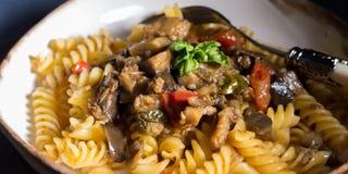 Fusilli pasta with eggplant sauce. Fusilli pasta with eggplant and tomato sauce. Traditional italian dish stock images