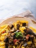 Fusilli pasta with eggplant sauce. Fusilli pasta with eggplant and tomato sauce. Traditional italian dish stock image