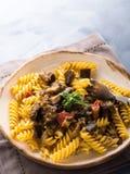 Fusilli pasta with eggplant sauce. Fusilli pasta with eggplant and tomato sauce. Traditional italian dish royalty free stock image