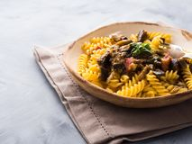 Fusilli pasta with eggplant sauce. Fusilli pasta with eggplant and tomato sauce. Traditional italian dish royalty free stock images