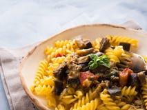 Fusilli pasta with eggplant sauce. Fusilli pasta with eggplant and tomato sauce. Traditional italian dish royalty free stock photo