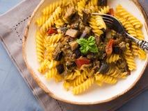 Fusilli pasta with eggplant sauce. Fusilli pasta with eggplant and tomato sauce. Traditional italian dish stock photography