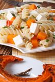 Fusilli pasta with feta and baked pumpkin close-up Stock Image