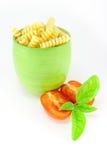 Fusilli pasta in a green jar Royalty Free Stock Photo