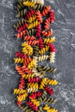 Fusilli pasta on grey stone table top view copyspace Stock Photos