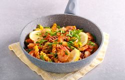 Fusilli pasta with lemony shrimps. In a frying pan stock images