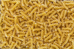 Fusilli pasta macro as background structure Royalty Free Stock Image