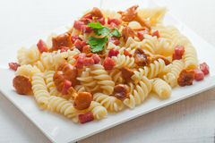Fusilli pasta with mushrooms and bacon. Royalty Free Stock Photo