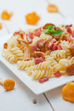 Fusilli pasta with mushrooms and bacon. Royalty Free Stock Images