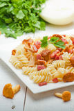 Fusilli pasta with mushrooms and bacon. Stock Photography