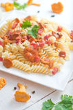 Fusilli pasta with mushrooms and bacon. Royalty Free Stock Photography