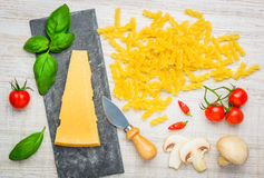 Fusilli Pasta and Parmesan Hard Cheese Stock Photo