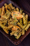 Fusilli pasta pesto Stock Photo