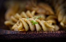 Fusilli pasta pesto. Italian cooking. Fusilli pasta with pesto basil sauce and chicken stock images