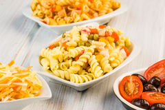Fusilli pasta salad cold. On wood Royalty Free Stock Images