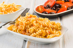 Fusilli pasta salad cold. On wood Royalty Free Stock Photo