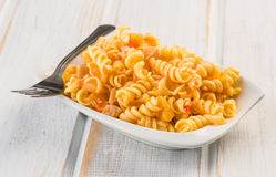 Fusilli pasta salad cold. On wood Stock Photo