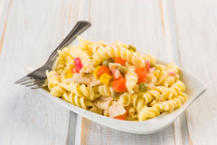 Fusilli pasta salad cold. On wood Stock Photography