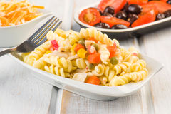 Fusilli pasta salad cold. On wood Stock Photos