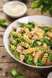 Fusilli pasta with salmon, spinach and grean peas stock image