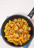 Fusilli pasta with sausage and vegetables Royalty Free Stock Photos