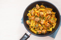 Fusilli pasta with sausage and vegetables Stock Images
