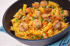 Fusilli pasta with sausage and vegetables Stock Image