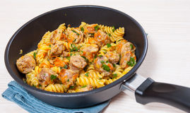 Fusilli pasta with sausage and vegetables Stock Photos