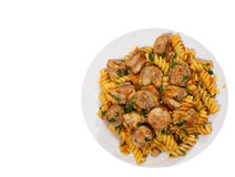 Fusilli pasta with sausage and vegetables. top view. isolated Royalty Free Stock Photography